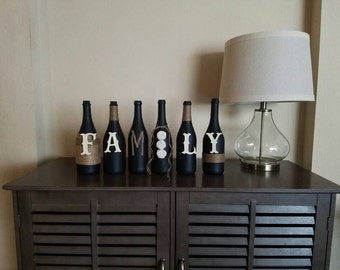 Family decorated wine bottles. Decorated wine bottles. Mantel decor. Home decor. Wine bottle decor.