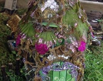 Colorful magical bark and leaf Fairy house for fairy garden