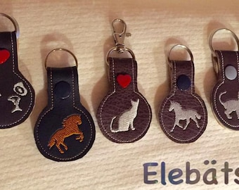 different tags embroidered, made of leather