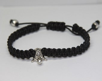 Black Macreme' and Turtle bead adjustable.