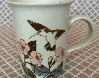Vintage speckled hummingbird mug - pink and blue - flying bird among flowers