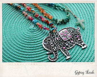 Elephant pendant necklace with real semi precious stone beads and 2 other semi precious stone necklaces.