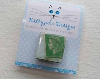 Postage stamp brooch. Vintage postage stamp inchie brooch