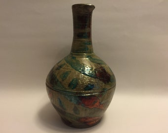 Raku fired pitcher/vase