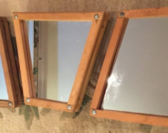 Vintage wooden tennis racquet presses made into wall mirrors!