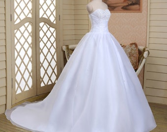 Large and white wedding to rhinestone dress