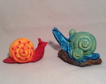 2 very colorful whimsical snails