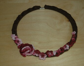 Brown and pink crocheted necklace.