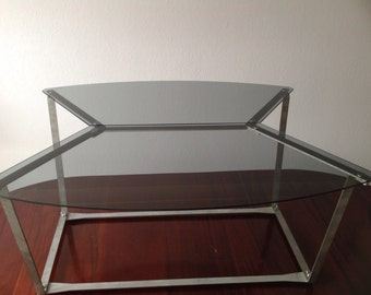 Unique designer Glass top Coffee table sleek stainless steel frame