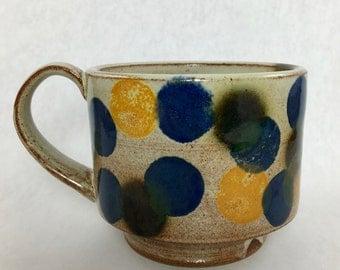 mug with colorful spots