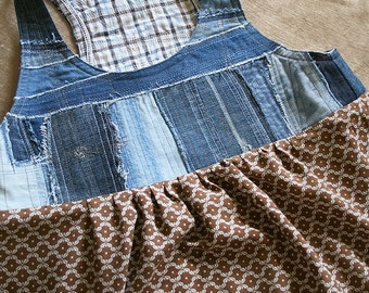 "A sleeveless dress ""Denim and viscose"""