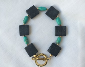 Turquoise and Blackstone Beaded Bracelet with Gold Accents and Toggle Clasp