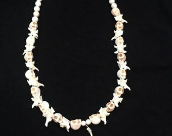 Rattlesnake vertebrae necklace.