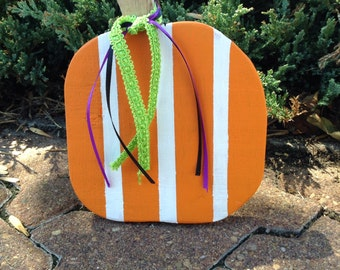Orange & white striped mini pumpkin.