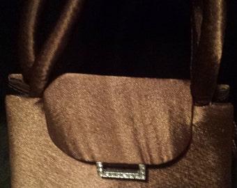 Brown satin handbag