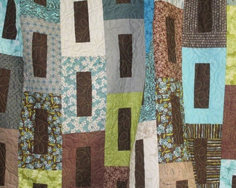 Browns, blues and greens quilt throw