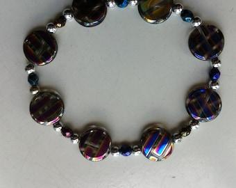 Rainbow coloured flat round beads on elastic