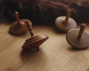 Woodturned spinning tops