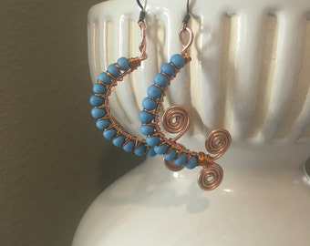 Turquoise and copper earrings.