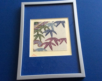 Framed antique kimono pieces on handmade rice paper