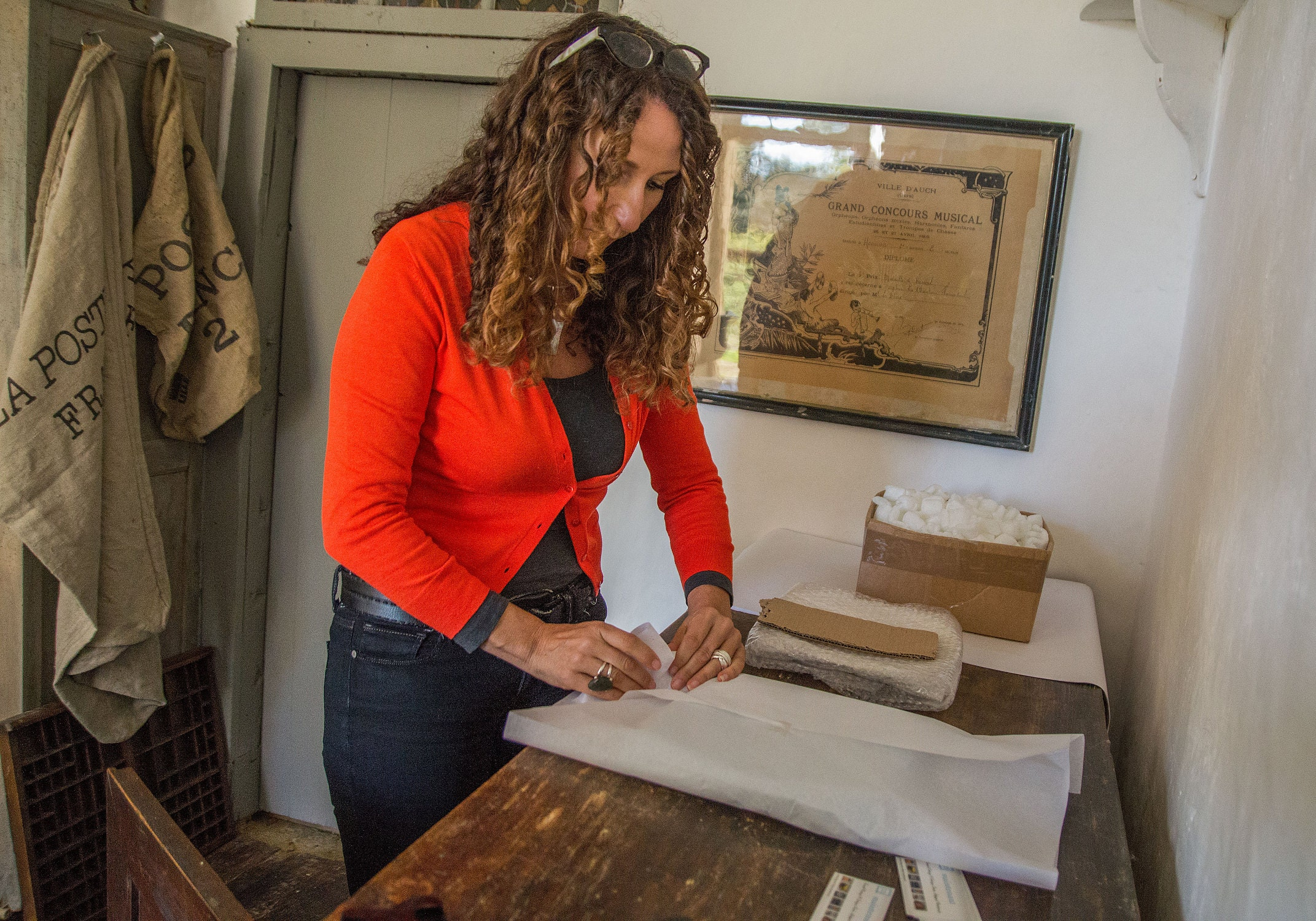 Christine packaging a vintage Etsy order