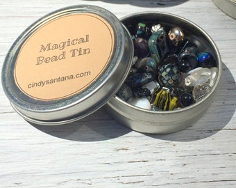 Glass beads, tin of beads, glass beads and more in a magical bead tin, black whte and metallic beads, 2.5 inch aluminum tin 2 ounces