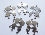 On Sale Vintage kissing cousins charms