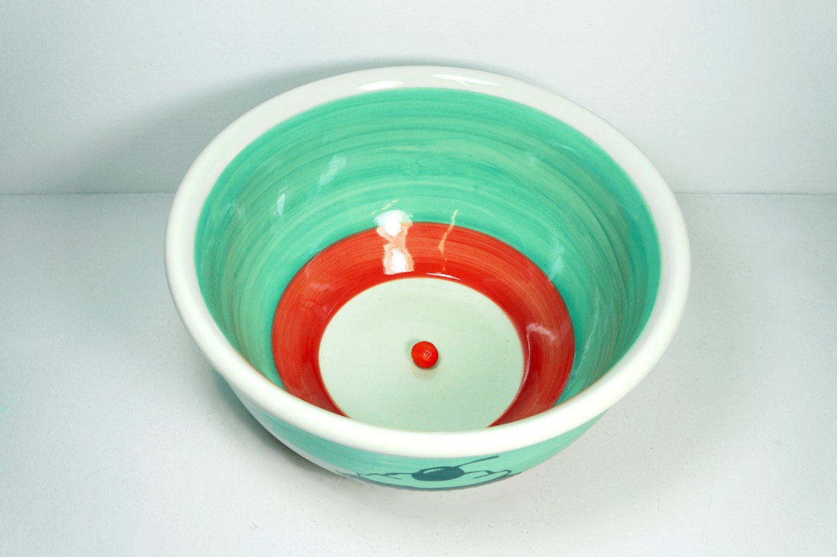 large bowl featuring a Cupcake print, on a colour block of Blue Green and Red-Orange. Made to Order.