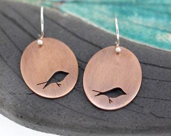 Little Birds copper hand pierced oval earrings