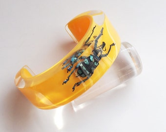 Bright yellow open cuff lucite bracelet with real insect