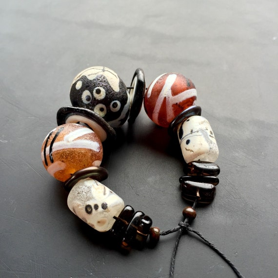 Handmade lampwork glass bead set by Lori Lochner Black amber and bone tribal mix jewelry and textile design supply