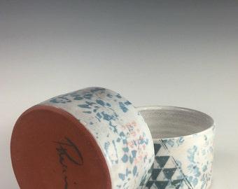 A pair of geometric bowls
