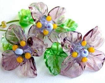 Handmade lampwork sculpted 3 iris flowers in amethyst  set