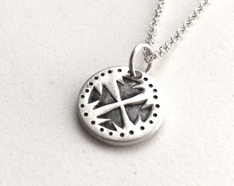Stamped Arrows Charm necklace in sterling silver.