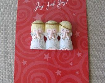 hallmark plastic Christmas pin brooch Joy Joy Joy three angels praying one angel peeking with tilted halo still on card