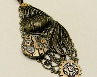 Steampunk pendant. Steampunk fish and watch pendant.
