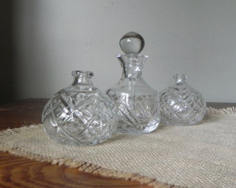Vintage cut glass vanity jars one with perfume dabber