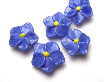 Forget Me Not Beads, handmade artisan lampwork glass in dark periwinkle blue