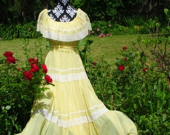 Boho vintage 70s canary yellow  maxi dress with a wide capelet style collar, two tiers, white lace. Made by Lorrie Deb. Size 6 ( tall).