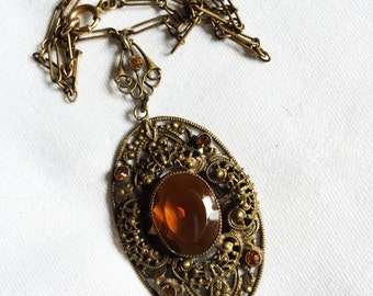 Vintage Pendant Necklace With Amber Colored Czech Glass. It is Set in Ornate Filigree Metal 2 Inch Pendant and Ornate 16 Inch Chain (D5)