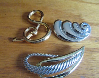 3 abstact brooches
