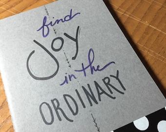 Hand lettered Moleskine journal