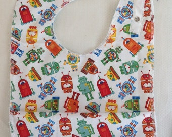 Baby bib with crumb catcher pocket with robots red reversible