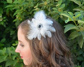 White natural feather plume fascinator with a black, silver and crystal pendant