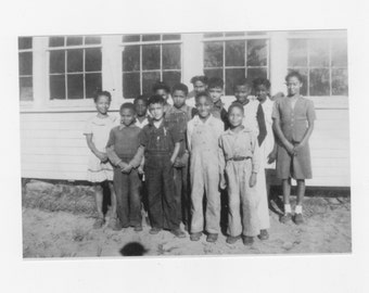 1930s  photograph of a group African Americans students by a one room school house reprint from original photograph