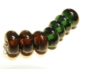 DESTASH -- Seven (7) Translucent Glass Rondelles: Dark Green and Sparkly Dark Brown  -- Lot 3F