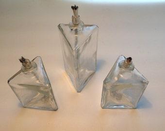 Three vintage oil lamps