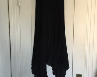 Black pleated asymmetrical maxi skirt