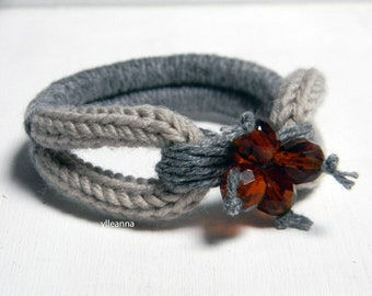 Wool bangle. Cashmere and glass bracelet. Beige and tweed light grey.