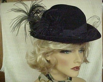 "Hat by designer ""Fabini- New York""  black wool with an emu side feather - fits 21"""